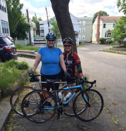Pata (right) and me, standing smilingly with our bikes, having our picture taken by the UPS guy.