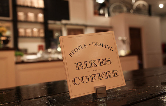 "sign in a cafe saying ""people demand bikes and coffee"""