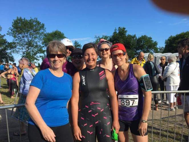 Bright sunny day for the group picture at Kincardine Triathlon and Duathlon. The front row (left to right) is Susan F, Carolyn, and Tara. The back row (left to right) is Susan T, Sam, and Sarah.
