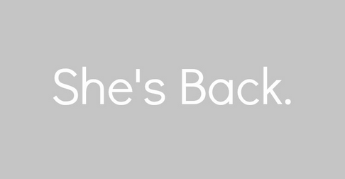"Graphic of the words ""She's Back."""