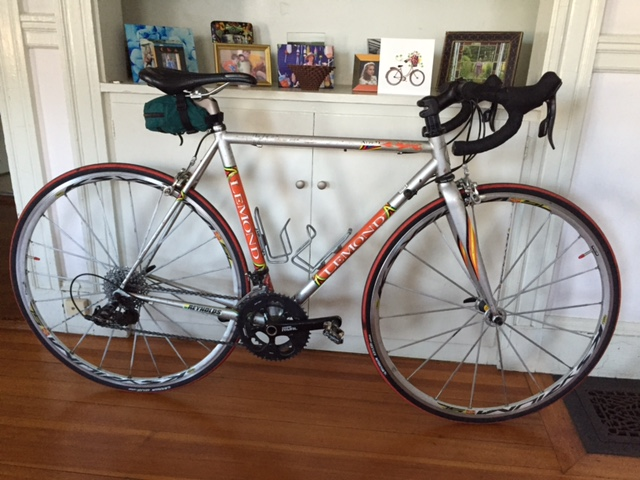 My old but adored road bike-- silver with orange decals, a little scratched up but always ready to ride.