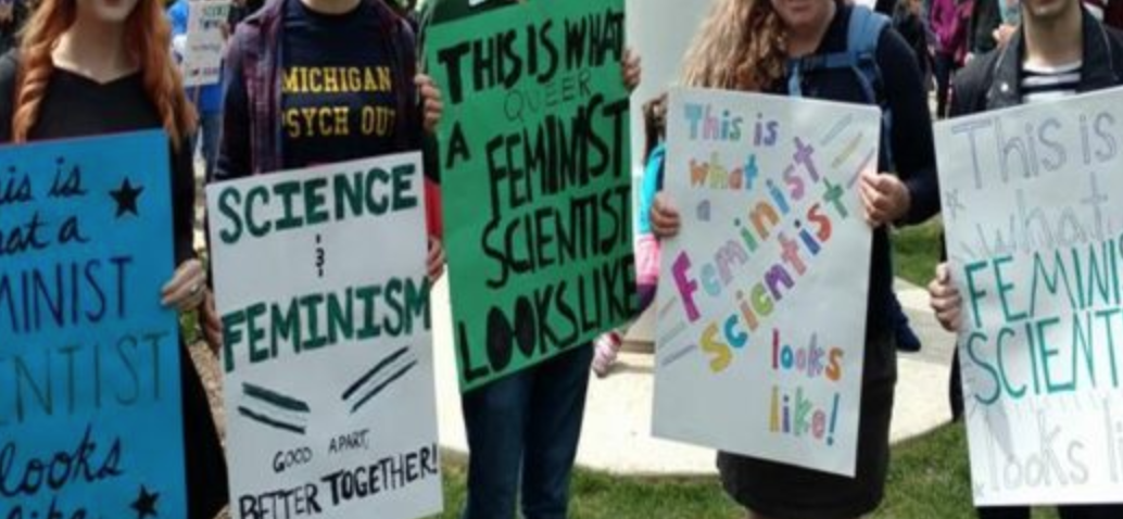 "Feminist science posters, with slogans like ""this is what feminist science looks like"" and ""science and feminism: better together"""