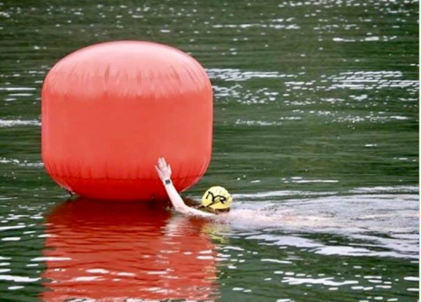 Me touching the finish buoy for my official time.