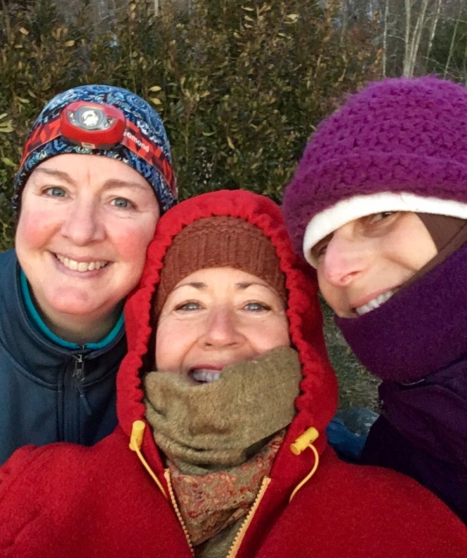 Catherine, Kim, and NIna, all bundled up in winter clothing for a winter solstice walk.
