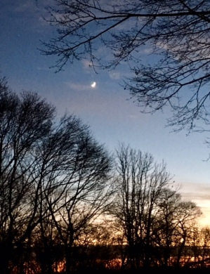 Another view of sunset and crescent moon.