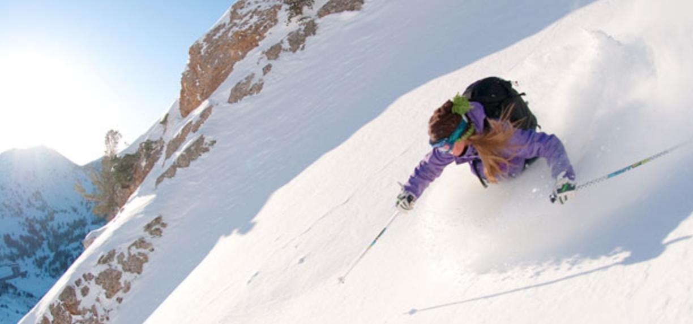 A woman skiing in deep powder at Alta in Utah.