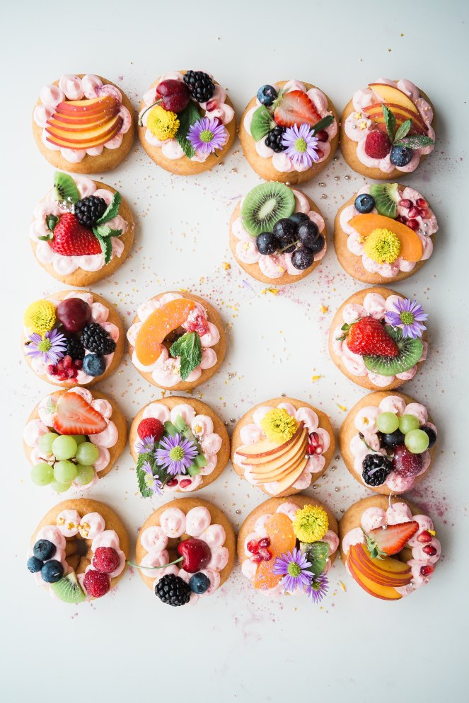 Donuts covered in fruit slices