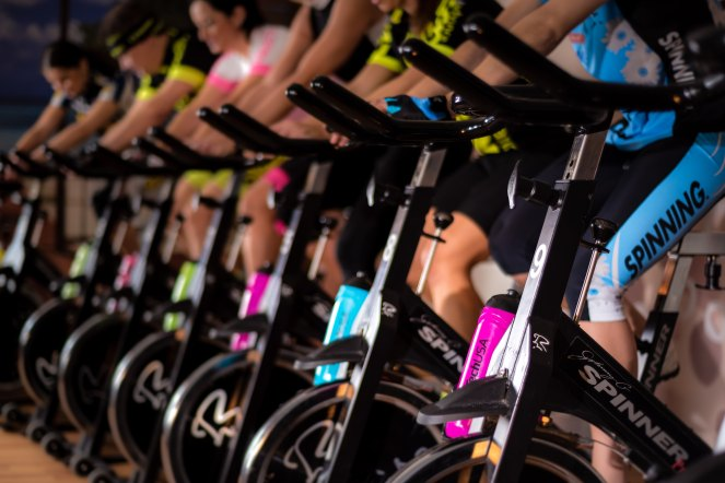 A row of spin bikes