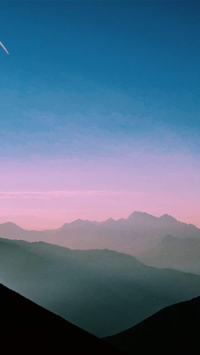 Blue and pink sky, outline of mountains