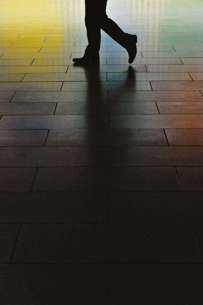 Feet walking in silhouette