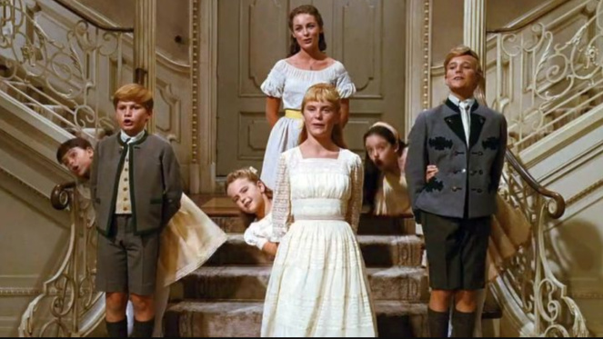 The children from The Sound of Music, singing and leaning, in formation.