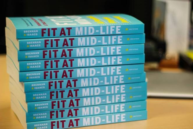 Image description: stack of 10 copies of Fit at Mid-Life, spines facing forward.