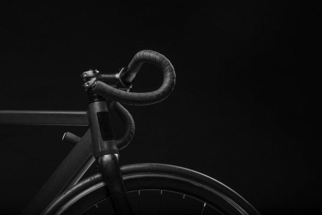 A black road bike on a black background