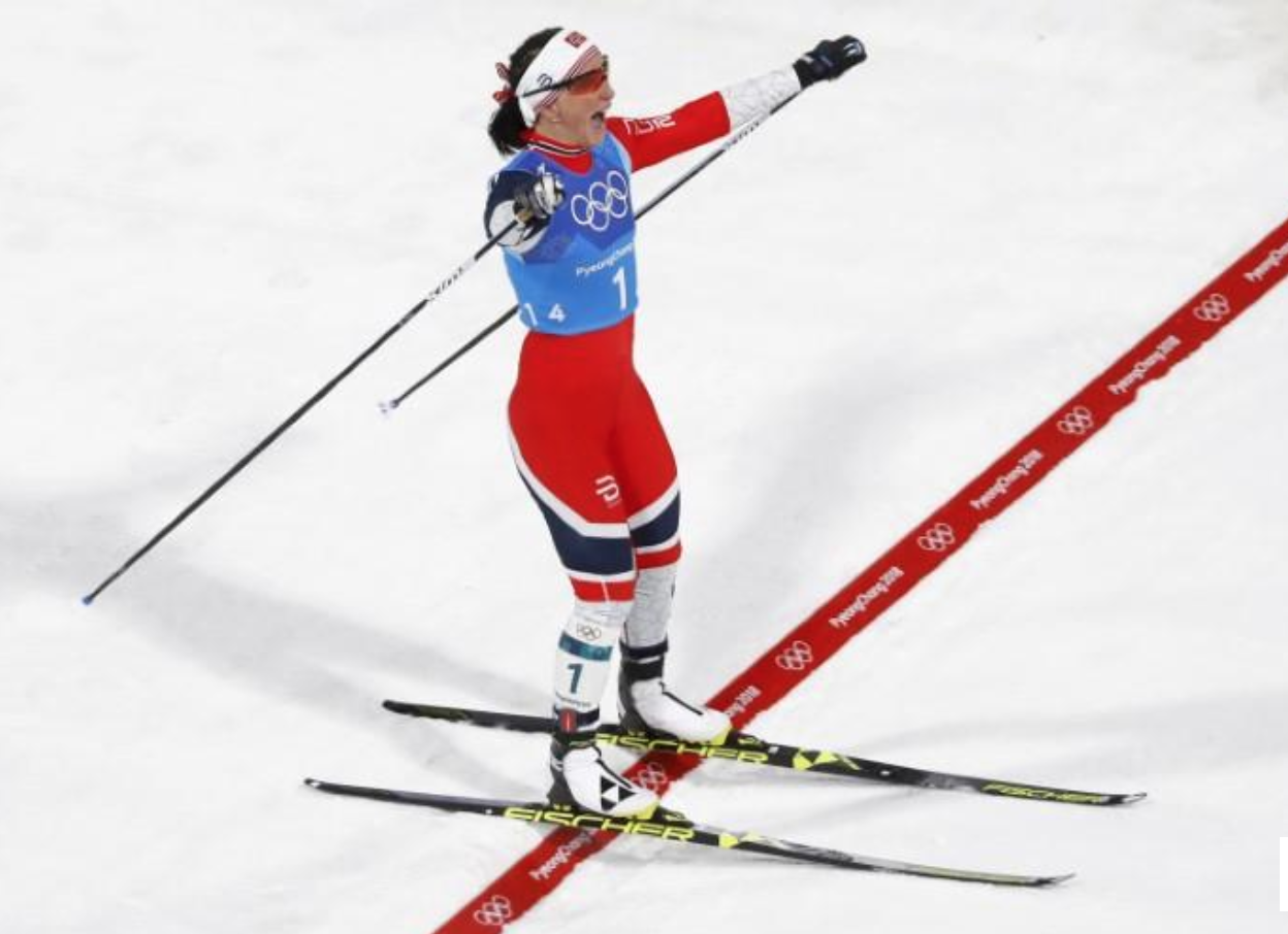 Marit Bjoergen of Norway, crossing the line to victory for her 13th Olympic gold medal.