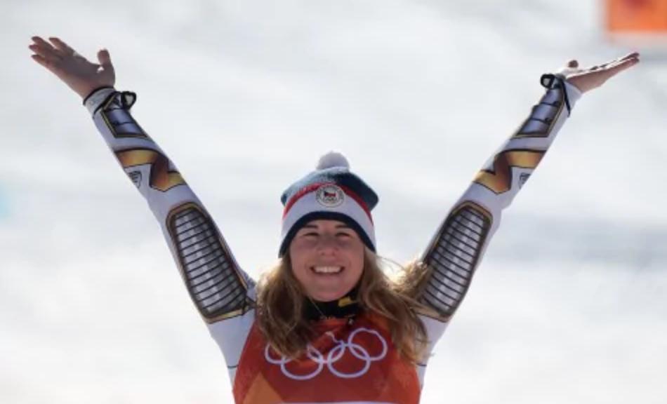 Ester Ledecka, her arms up in a V for victory gesture.