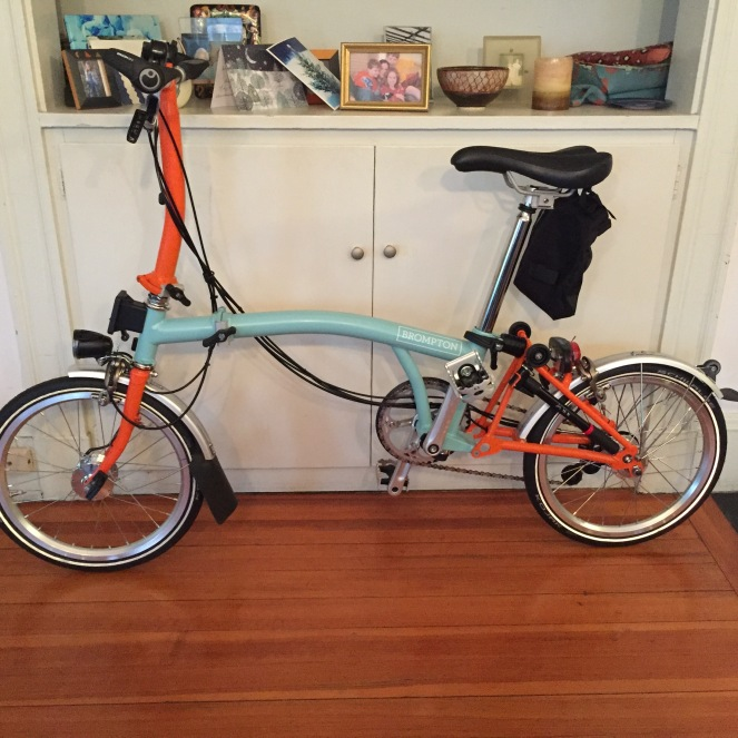My Brompton folding bike, in all its orange and celadon-green glory.