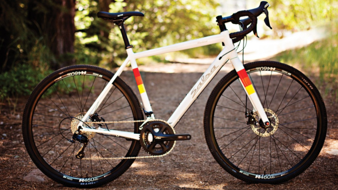 A Salsa Warbird, with shimano 105 components and a white frame with  red, orange an yellow stripes. Gorgeous.