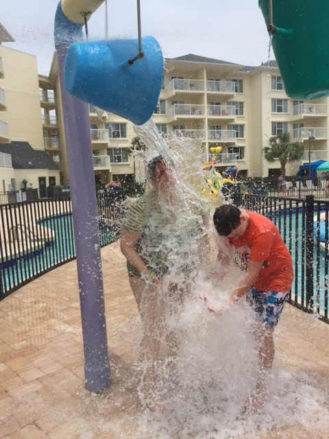 My nephew and I being deluge by a bucket of water pouring on us at the water park.