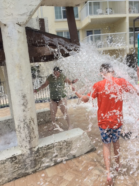 My nephew and me, getting drenched again by a barrelful of water.