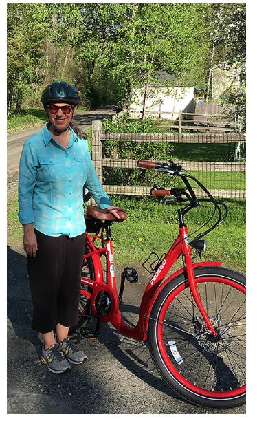 Aruni and Boomer, a big red bike and her new two-wheeled partner in the Berkshires of western Massachusetts.