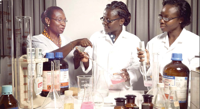 African women scientists in a lab, going over procedures.