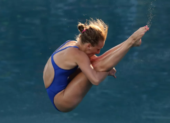 Abby Johnston, in the middle of a 3-meter springboard dive.