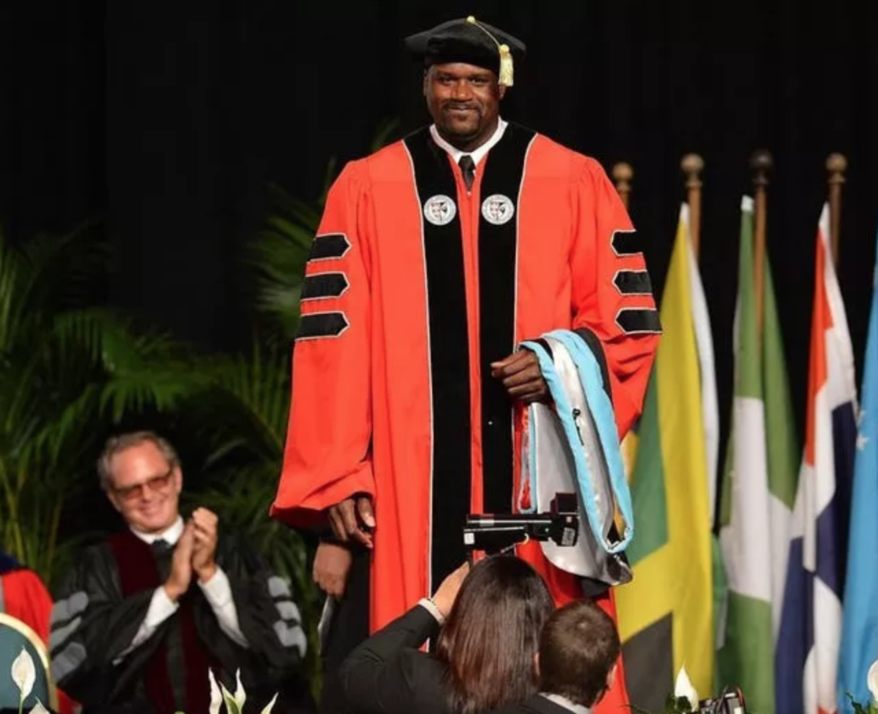 Former pro basketball player Shaquille O'Neal, receiving his doctorate in education from Barry University.