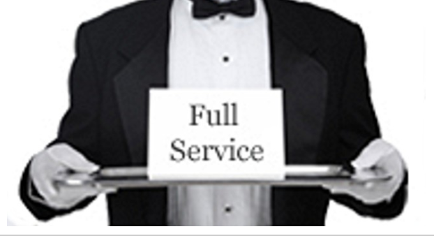 "Person in tuxedo, holding a tray with message ""full service""."