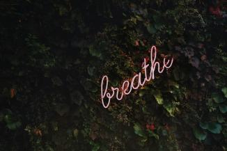 breath in neon signage