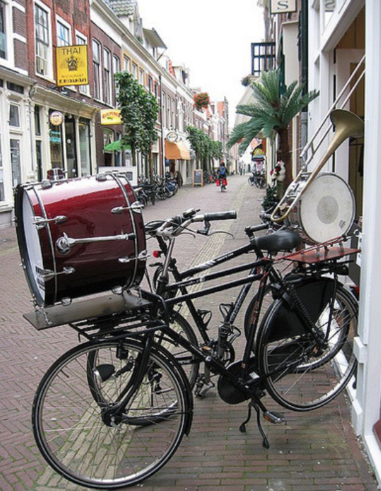 A bicycle in New Orleans, with a bass drum, trombone, and snare drum mounted on it.