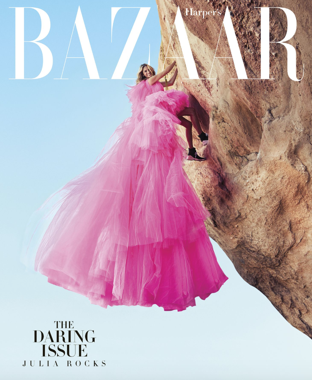 The cover of Harper's Bazaar magazine, with Julia Roberts clinging to a rock outcropping in a very big, very pink tulle dress.
