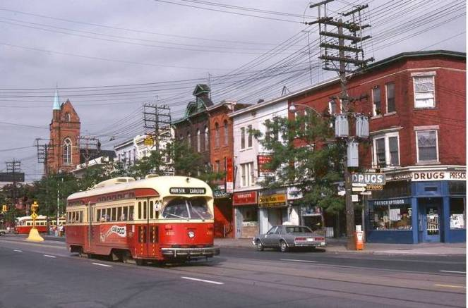 Toronto street car from https://chuckmantorontonostalgia.files.wordpress.com/2012/02/photo-toronto-college-street-streetcars-stores-1970s.jpg