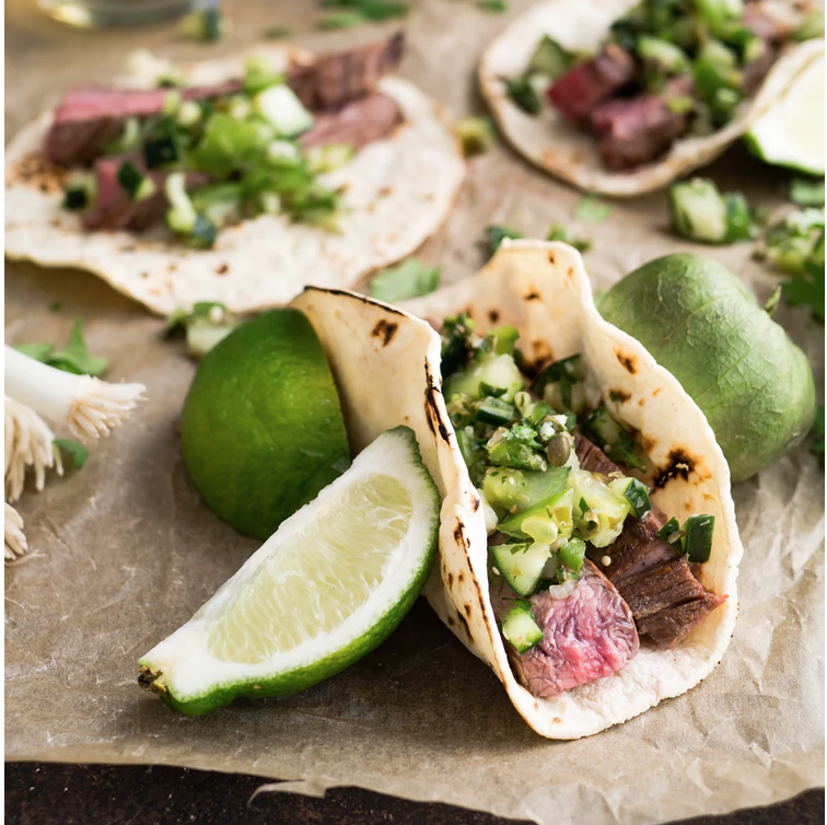 Tortillas with green salsa, herbs, avocado, and rare meat (dunno what).