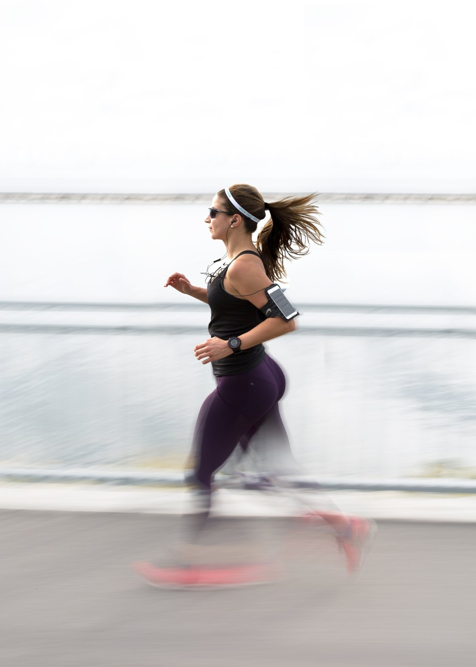 woman running with iphone