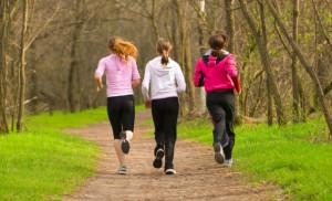 three women running on a trail