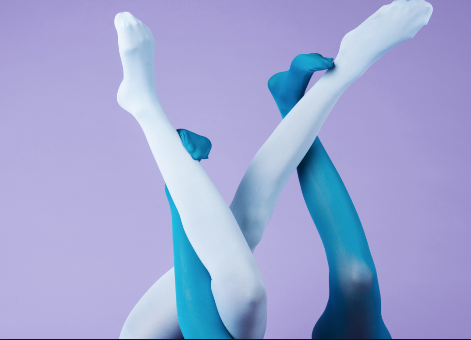 Two pairs of legs in blue tights intermingled-- I don't know what activity this is, but it seems like a happy image, so here you go.
