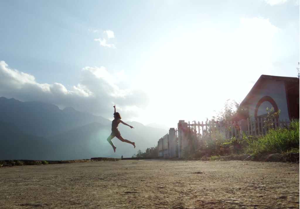 Woman leaping on a beach.