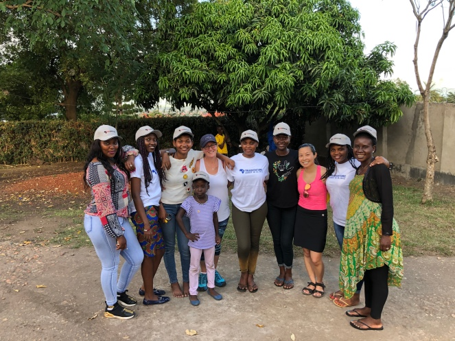 7 young Ugandan women, one in her 30s and pregnant, a little Ugandan, and two Canadian women, one white and one tiny Chinese-Canadian woman.