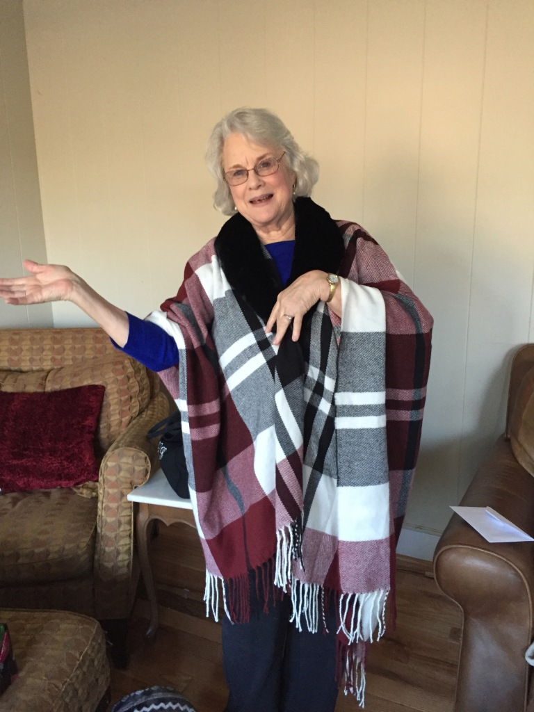 My mother Beth, showing off her new Christmas poncho.