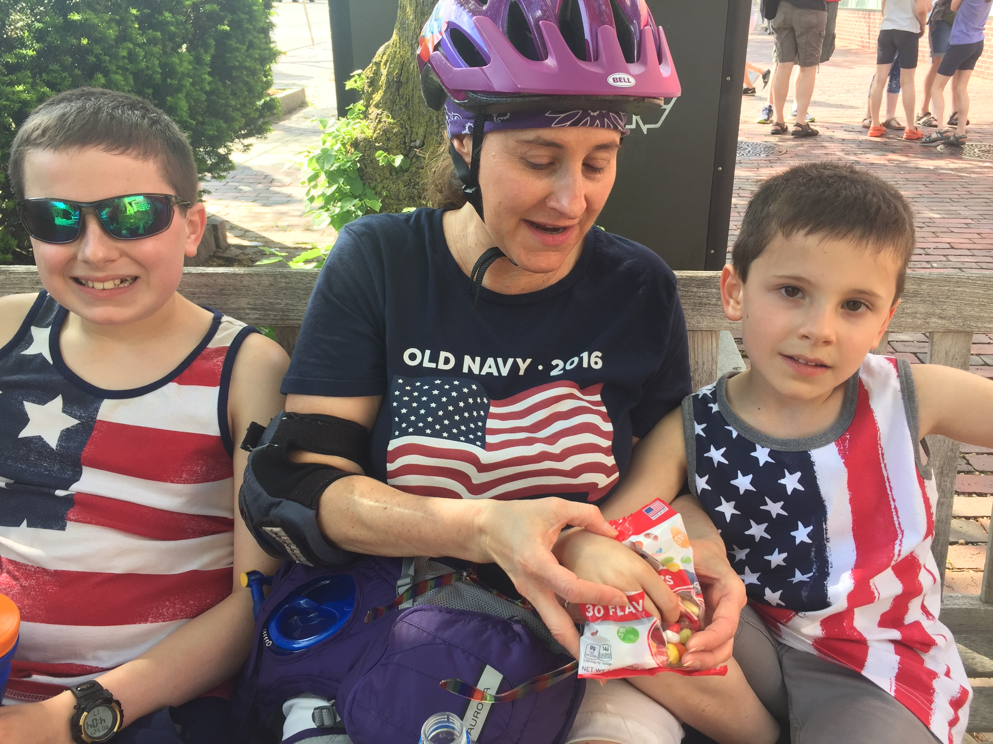 A nice woman and her two kids, enjoying a jelly bean break during a cycling/skating outing.