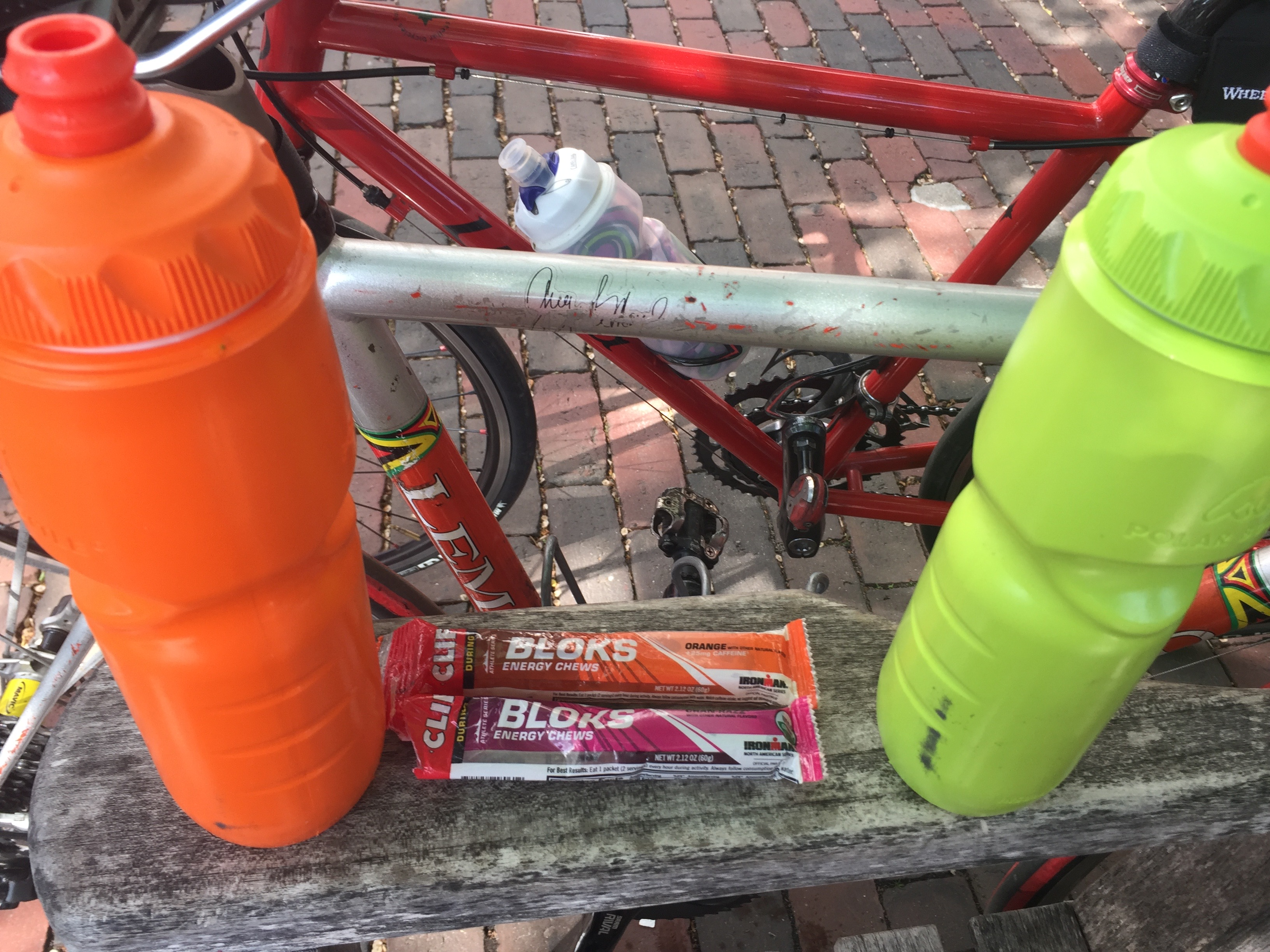 My two bike bottles (with orange gatorade) flanking two packs of clif shot bloks. The bikes are still waiting.