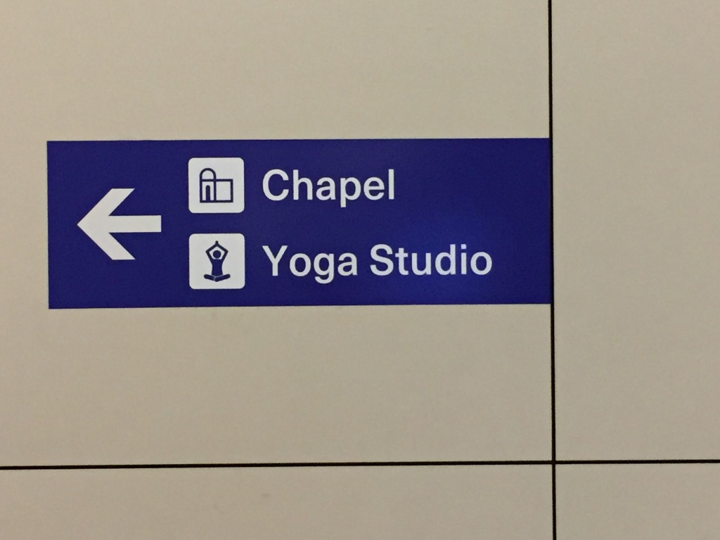 A sign indicating a Chapel and Yoga studio to the left. Left I go, then.