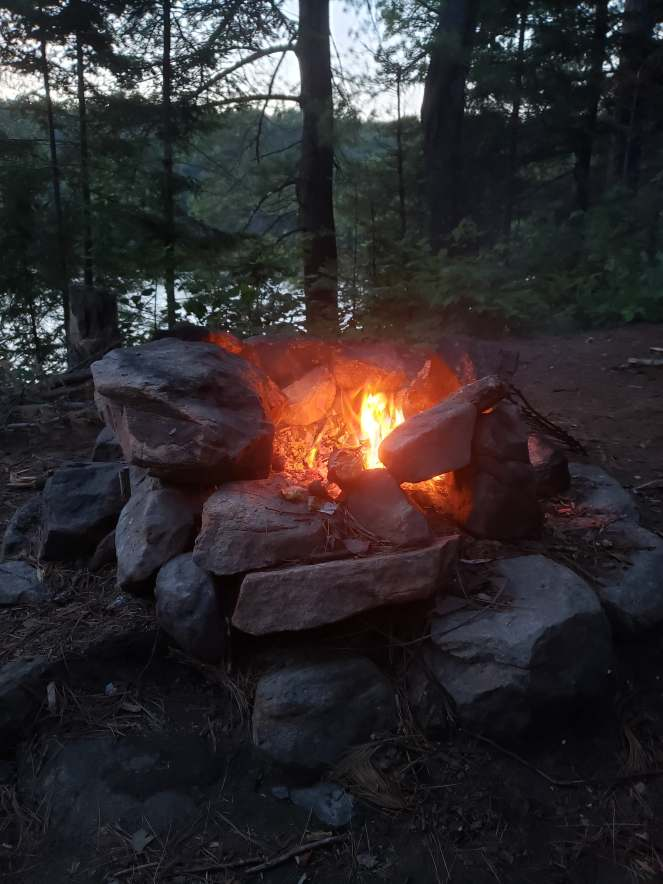 A camp fire at twilight