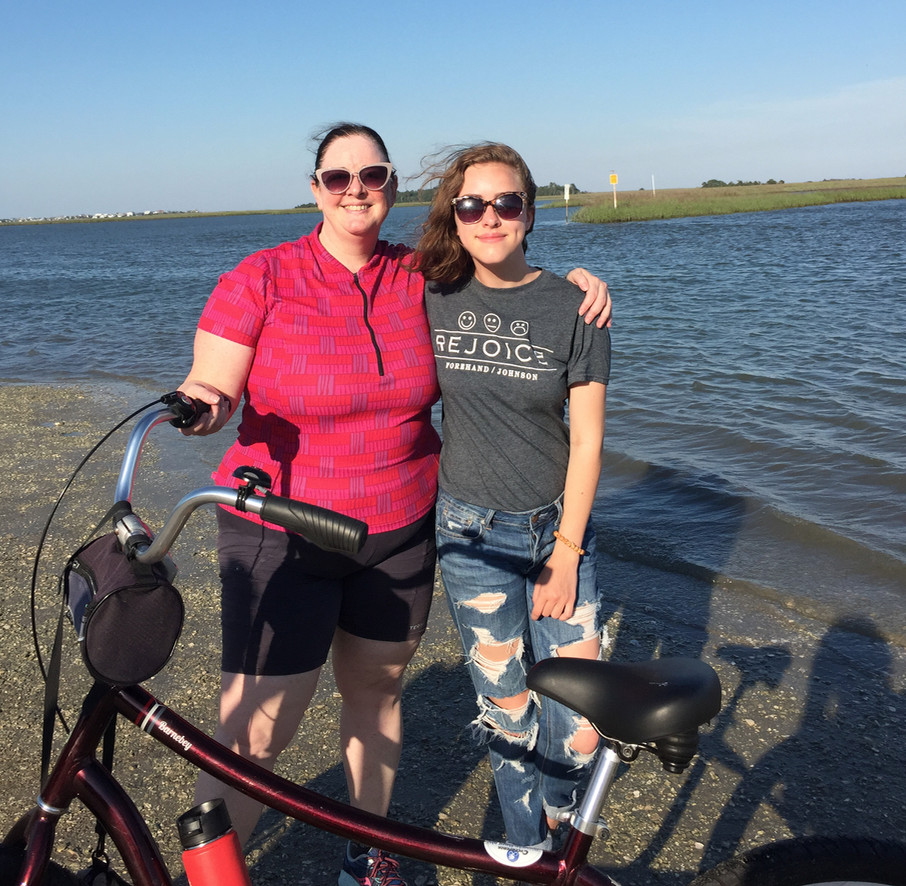 My niece Gracie and me, stopping by the marsh on a beach ride, 2018.