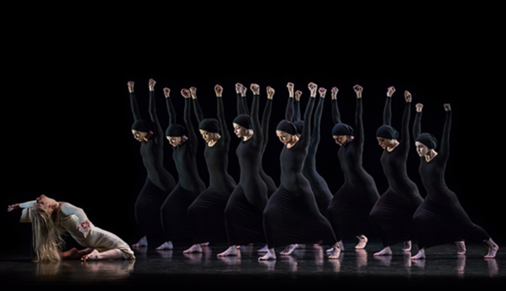 Heretic, choreographed in 1929. Women in black unitards, lunging, arms in air.