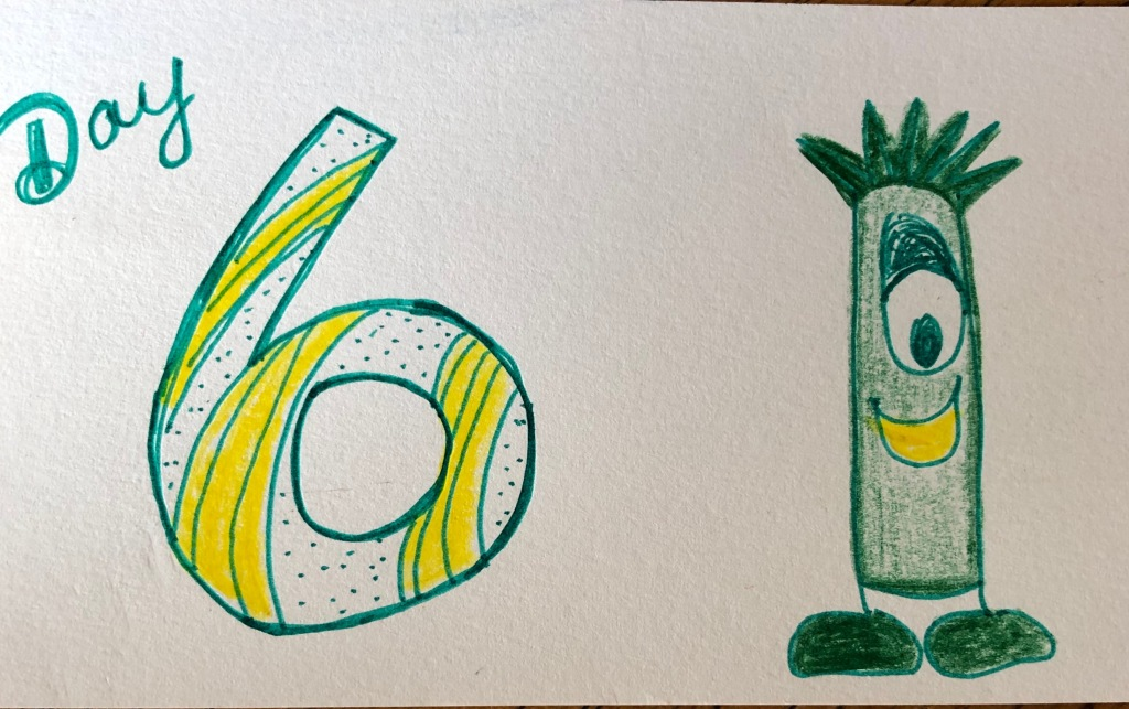 The words/numbers Day 6 are handwritten in large print on the left side of a white index card. On the right there is a tall, green, cylindrical one-eyed monster with a yellow smile and two green feet.
