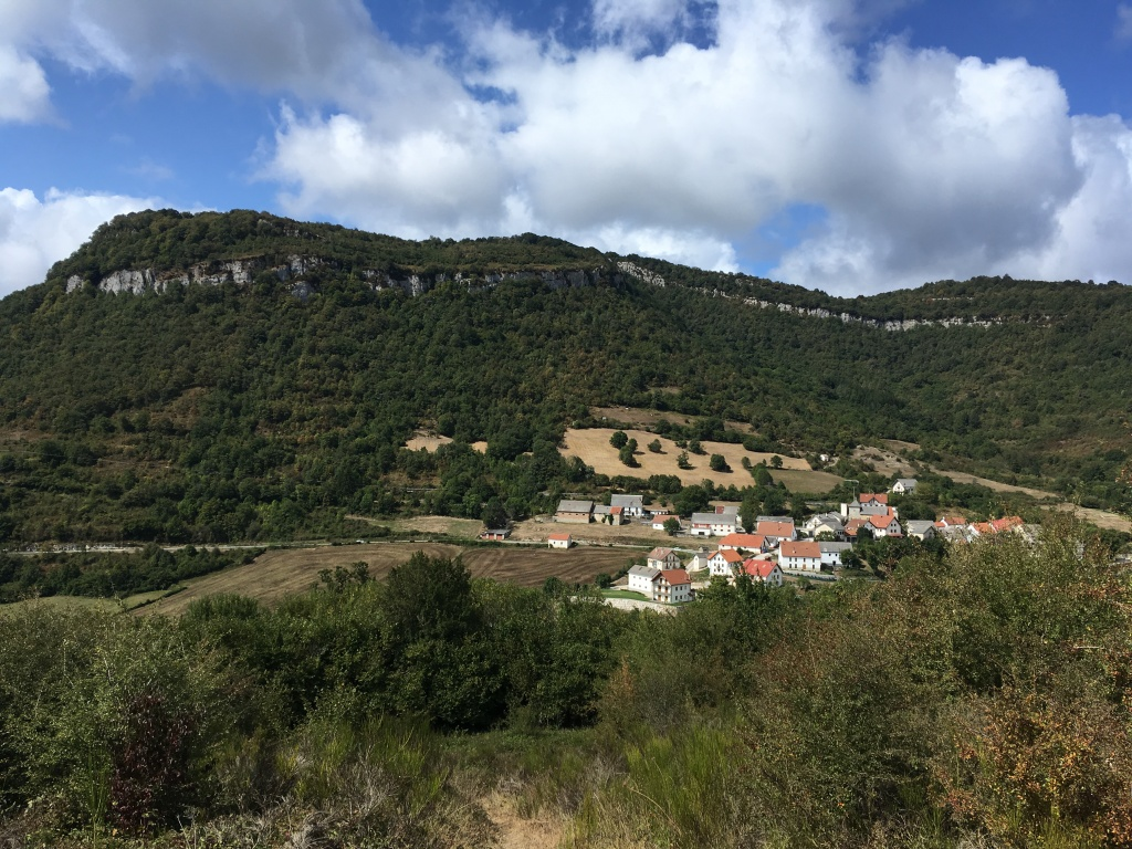a small hamlet nestled into a valley beneath a mountain