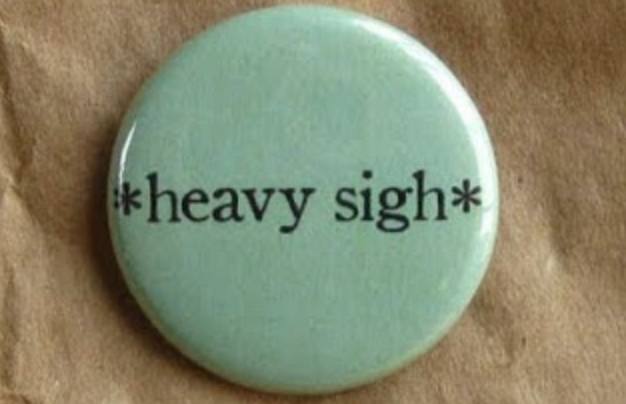 "a pin that says ""heavy sigh""."