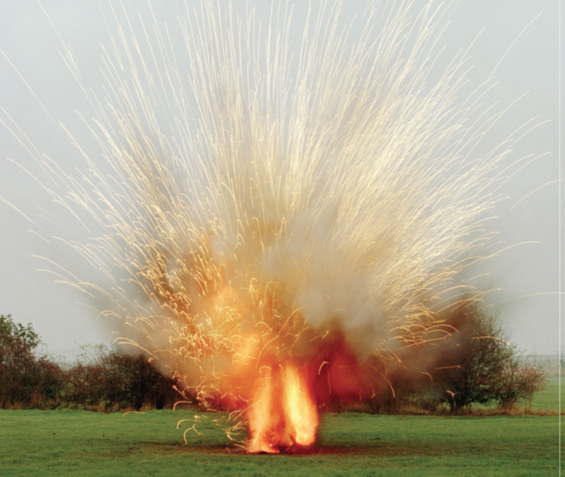 an explosion in a field.