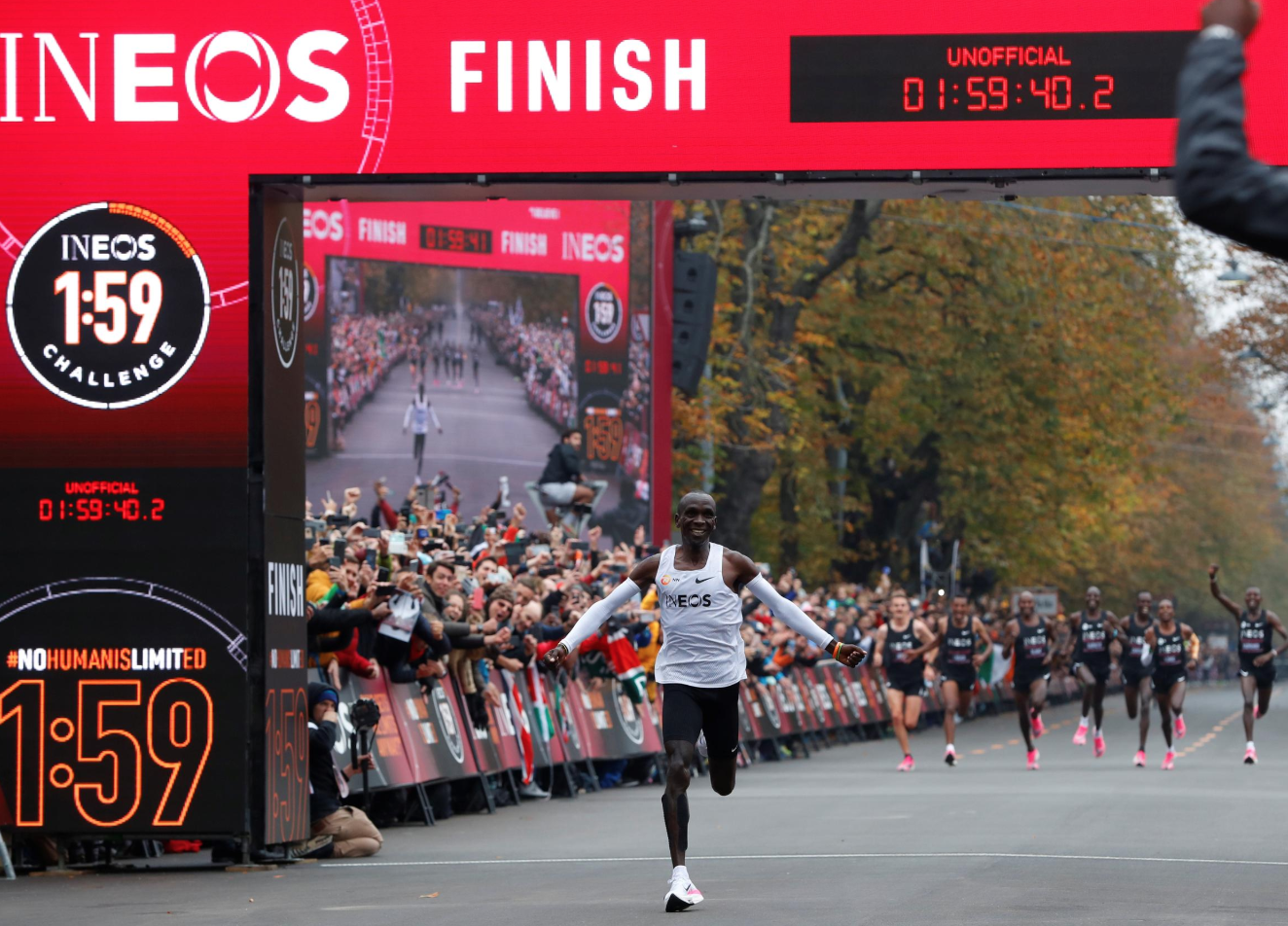 Eliud Kipchoge of Kenya, crossing the line in Austria in 1:59:40.